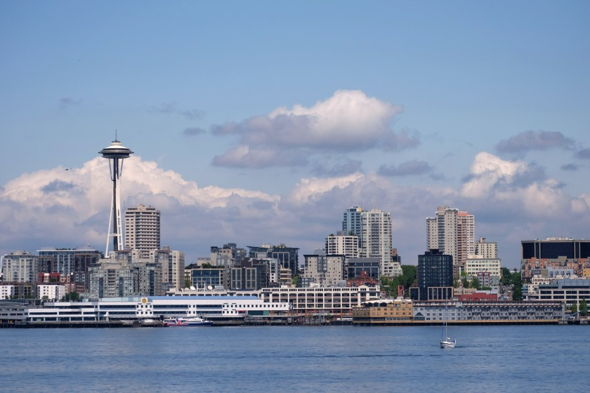 seattle space needle clouds horizon ferry water puget sound cityscape buildings